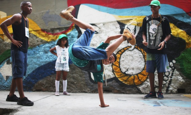 A competitor warms up ahead of the Passinho battle during celebrations marking Day of the Favela in the Madureira favela ...