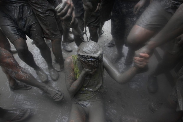 Festival-goers enjoy the mud during the annual Boryeong Mud Festival at Daecheon Beach in Boryeong, South Korea. The ...