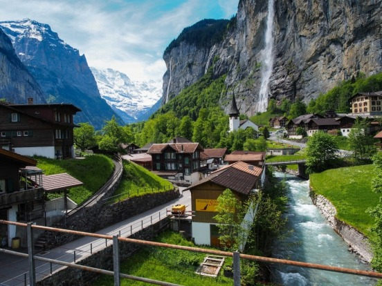 On the train to Jungfraujoch in the Swiss Alps, we passed this beautiful little village called Lauterbrunnen. It is a ...
