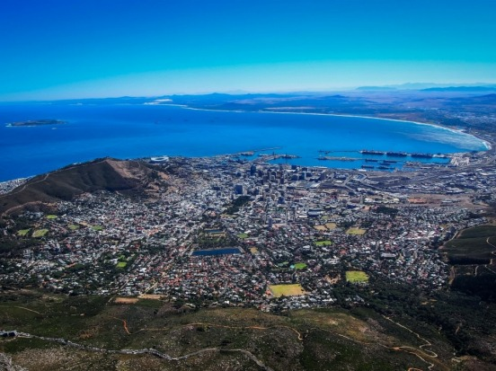 This is a view of Cape Town, South Africa, from the top of table mountain. Africa stretches off forever, punctuated by ...
