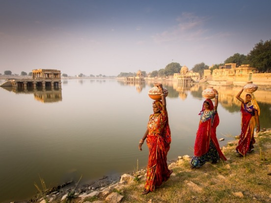 The women of Rajastan are beautifully clothed. I came upon these three women collecting water at Gadi Sagar Lake in ...