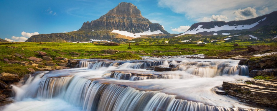 Logan Pass in Montana reveals mountains sculpted by glaciers into dramatic shapes.
