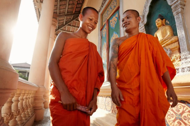 """""""Two buddhist monks meeting and saluting in a temple, Phnom, Penh, Cambodia, Asia."""