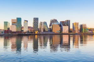 Modern buildings in Oslo, Norway, with their reflection into the water. These are some of the new buildings in the ...