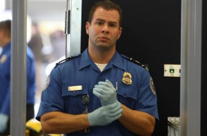 LOS ANGELES - NOVEMBER 22  A TSA agent waits for passengers to pass through a magnetometer at Los Angeles International ...