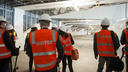 Stephen Byron escorts media on a guided tour of the construction site of the $18 million fitout for the new ...