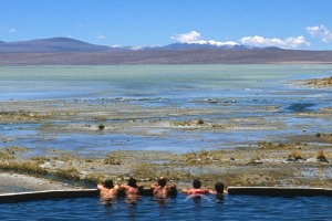 Tourists relax in the thermal pools in the Bolivian Altiplano.