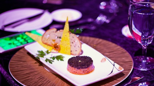 Wild salmon tartare with imperial caviar, by chef Joel Robuchon, is served as the first course during the inaugural ...