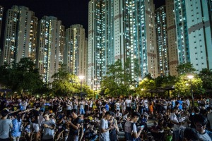 People play the Pokemon Go game at a park at Tin Shui Wai in Hong Kong.