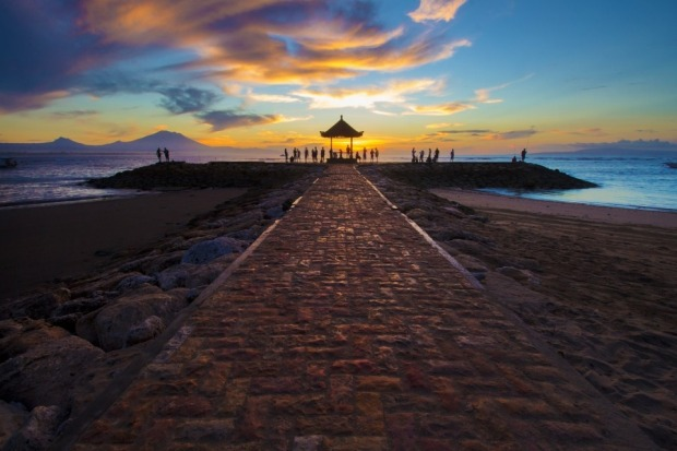 The stunning Sanur beach is one of the best places to view sunrise in all of Bali.