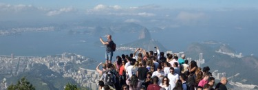 Rio Crush. A panorama of Rio, from Christ the Redeemer.This was the crush on an afternoon in June. A man balances on a ...