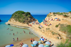 Visit a quiet, secluded beach with 1000 of your close friends in Corfu.