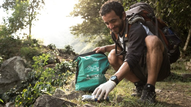 Tidying up while enjoying a trek is one of many volunteer options available to travellers.