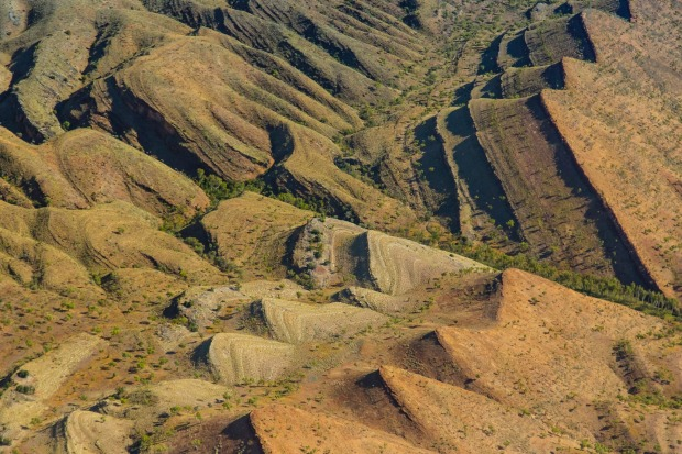 An aerial view of rock formations in Bungle Bungle Range, a UNESCO World Heritage Site in Purnululu National Park, ...