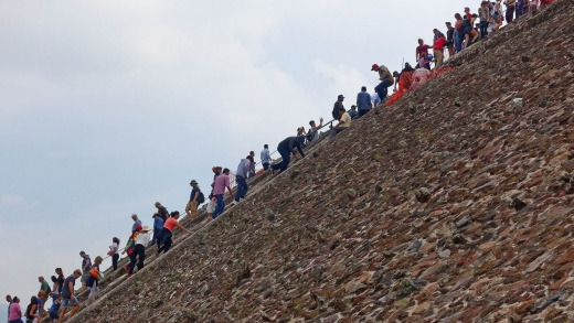 Tourists pass each other on the stairs of the Pyramid of the Sun.