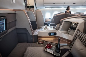 Passenger seats sit in the business class cabin of an Airbus SE A350 aircraft, operated by Singapore Airlines Ltd., ...