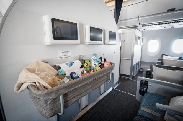 A baby bassinet at a bulkhead of the economy class cabin of a Singapore Airlines A350.