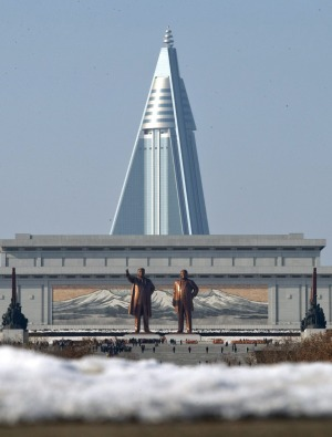 Statues of late leaders Kim Il Sung, left, and Kim Jong Il, right, at Mansu Hill near the Ryugyong Hotel.