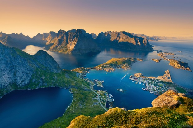 Lofoten Islands, located in Norway, during summer sunset.