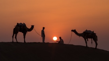 Khuri is a small mud walled village near Jaisalmer in Rajasthan India. The desert surrounding the village is ...