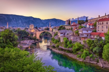 The old Mostar Bridge is Bosnia & Herzegovina has long been a symbol of Christianity & Islam united together as a ...