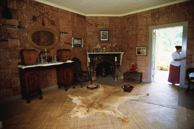 Robert Louis Stevenson's living room decorated with antiques, cultural artifacts and the imported fireplace which was ...