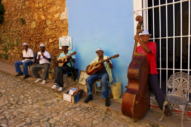 A street band playing hot salsa in the streets of historic Trinidad, Cuba.