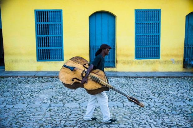 Bass player carries his instrument home after a gig.