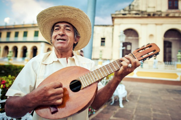 Man playing mandolin in Trinidad, Cuba.