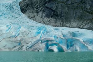 A glacial blue lake at the bottom of the Briksdalbreen Glacier.