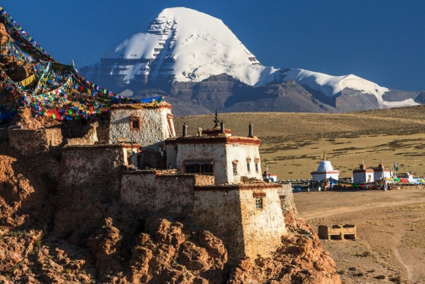 Twilight over Chiu Gompa (Jiwusi), with Mount Kailash in the background. The ancient buddhist monastery sits on top of a ...