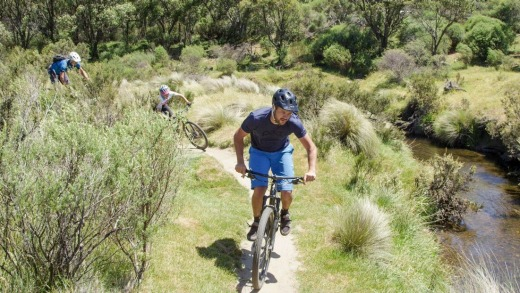 Pedalling the trails at Lake Crackenback resort.