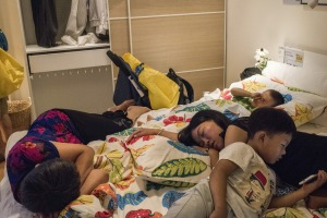 A family takes time to rest on a display bed at an IKEA store in Beijing.