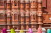 Women in bright saris in front of the Hawa Mahal (Palace of the Winds), built in 1799, Jaipur, Rajasthan, India.