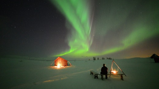 Northern lights tour in sweden seeking the world 39 s no 1 for Ice fishing at night