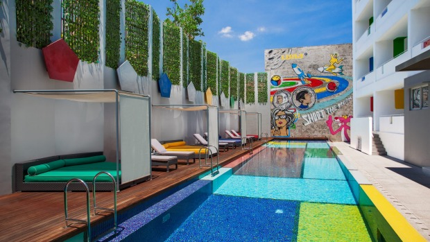 Makes you smile: The pool and graffiti wall at Luna2.