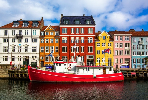 Colourful houses and boats at Nyhavn, Copenhagen Denmark.
