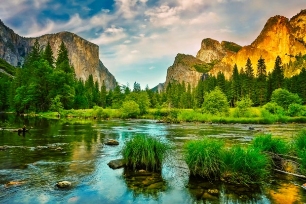 Sunset over Yosemite Valley reflected in Merced River.