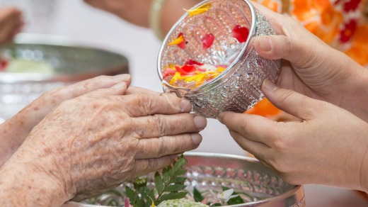 Pouring water on the hands of revered elders gives a blessing.
