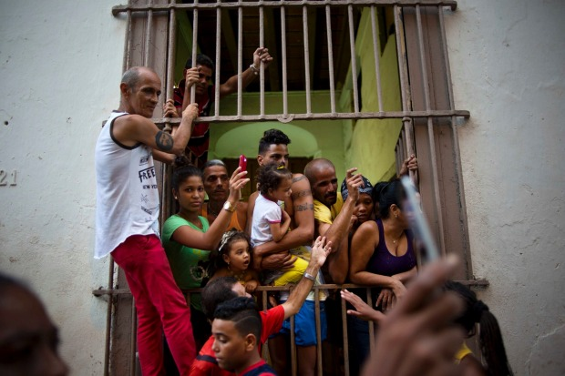 Faithful watch the procession honoring the Virgin of Charity of Cobre, on her feast day in Havana, Cuba.