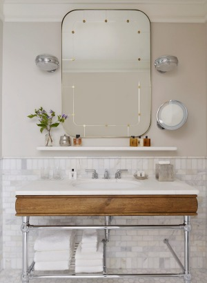 The spacious Carrara marble bathroom features toiletries by Brooklyn-based perfumer D.S. and Durga.