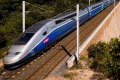 Anth?or, France, September 27, 2014 : A french high speed train TGV running over a viaduct alongside mediterranean ...