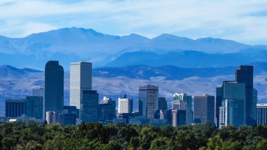 The Denver city skyline, downtown against the backdrop of the Rocky Mountains.