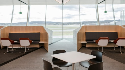 Floor-to-ceiling windows provide natural light and a clear view of the runways.