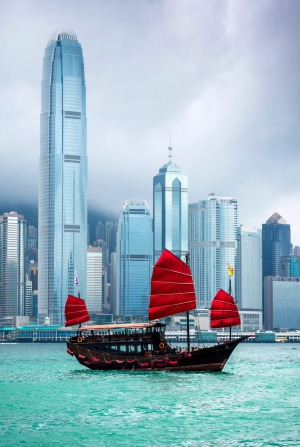 Traditional Chinese Junkboat sailing across Victoria Harbour, Hong Kong.