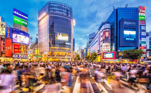 The famous Shibuya Crossing in Tokyo during rush hour.