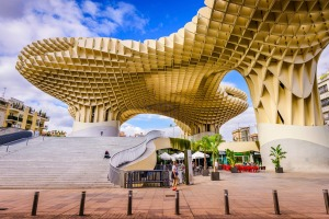 Seville, Spain - November 7, 2014: A Pedestrian passes the Metropol Parasol. Located in the old quarter, the structure ...