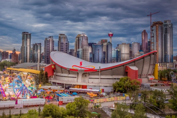 Calgary's skyline at night featuring the Scotiabank Saddledome, Alberta, Canada.
