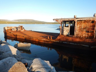 Even a rust bucket can look attractive in the right late evening light which we were lucky to encounter in Makkovik, ...