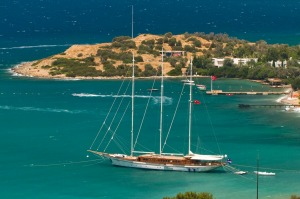 A gulet (traditional Turkish wooden sailing vessel) moors in scenic Bodrum.